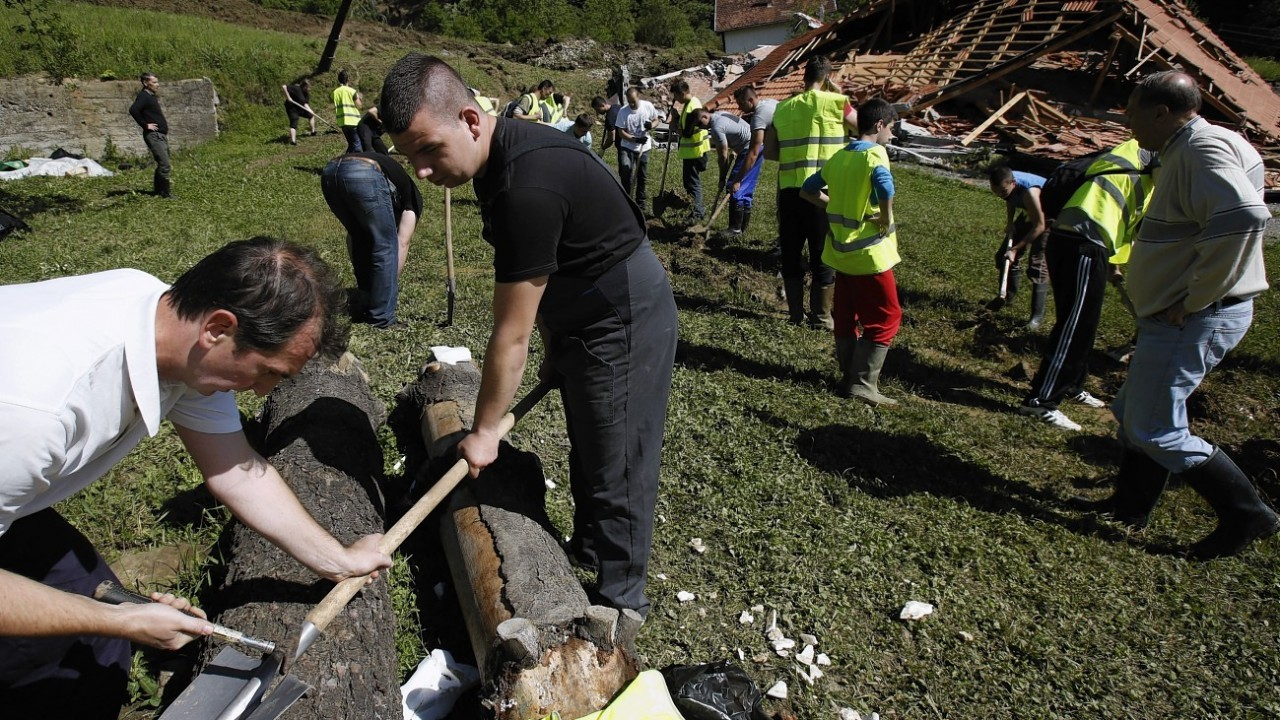 Bosnian volunteers work to save the remains of a village after a landslide near Tuzla, 140 kms north of Sarajevo
