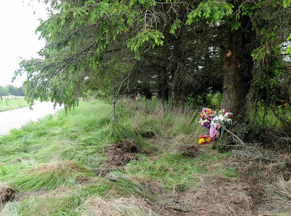 Floral tributes left at the scene near Culbokie