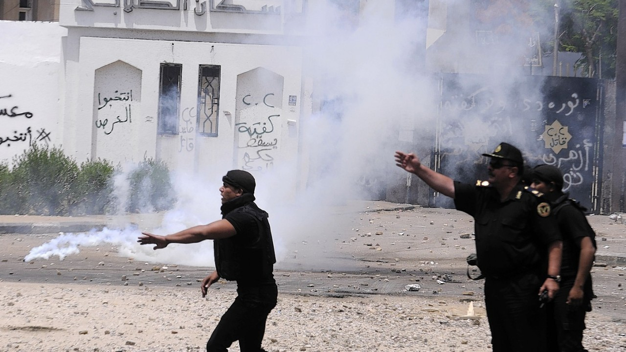 Egyptian security forces direct others during clashes with student protesters at a student housing area of Al-Azhar University in Cairo, Egypt,