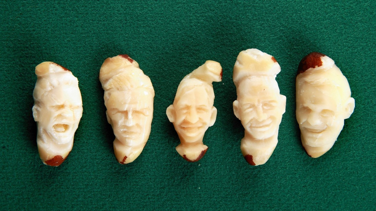 Micro-artist Quentin Devine carves portraits of England football players (left to right) Paul Gascoigne, David Beckham, Gary Lineker, Alan Shearer and Wayne Rooney