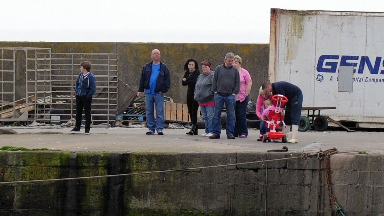 Families and locals have been waiting at the harbour for information