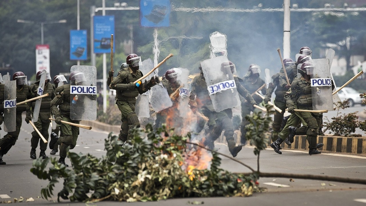 Kenyan university students on Tuesday carried out demonstrations over a proposed increase in student fees, but the protests quickly turned into hours of running battles between students throwing rocks and security forces firing tear gas, before riot police chased the students inside their campus and cornered them in a building into which they fired dozens of tear gas grenades and for a while prevented anyone from leaving