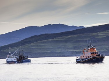 Fishing vessel under tow by Tobermory lifeboat