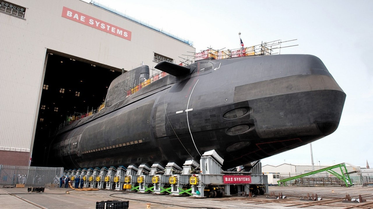 Astute class submarine Artful, designed and built by BAE Systems for the Royal Navy, as it rolls out of the Devonshire Dock Hall in Barrow-in-Furness, Cumbria, where it was constructed