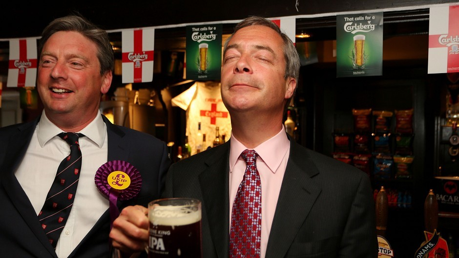 Ukip leader Nigel Farage, right, takes a moment to enjoy his party's success in the local elections