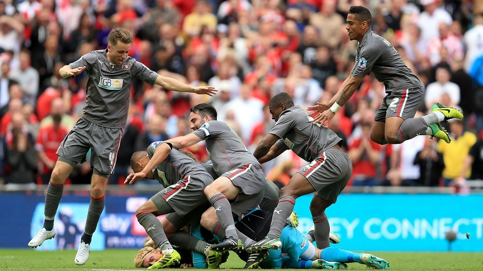 Rotherham goalkeeper Adam Collin is mobbed by his teammates after penalty shoot-out win.