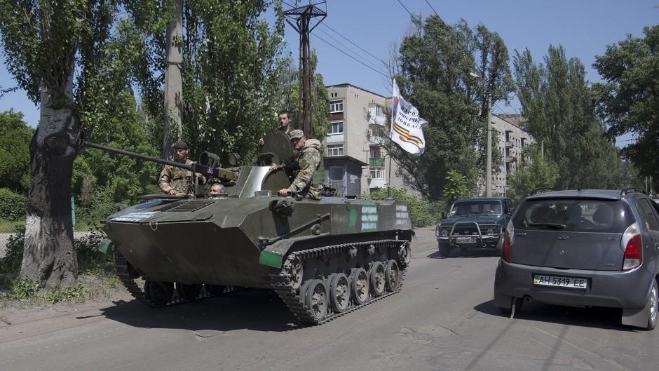 Pro-Russian militants in an armoured personal carrier guard streets in Slovyansk, eastern Ukraine. (AP Photo/Alexander Zemlianichenko, File)