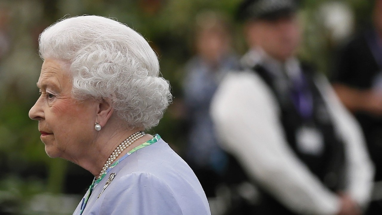 Queen Elizabeth II looks at a display during a visit to the Chelsea Flower Show