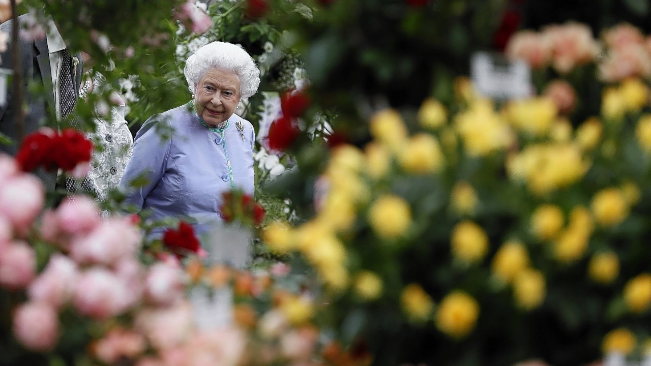 Queen Elizabeth II looks at a display during a visit to the Chelsea Flower Show in London