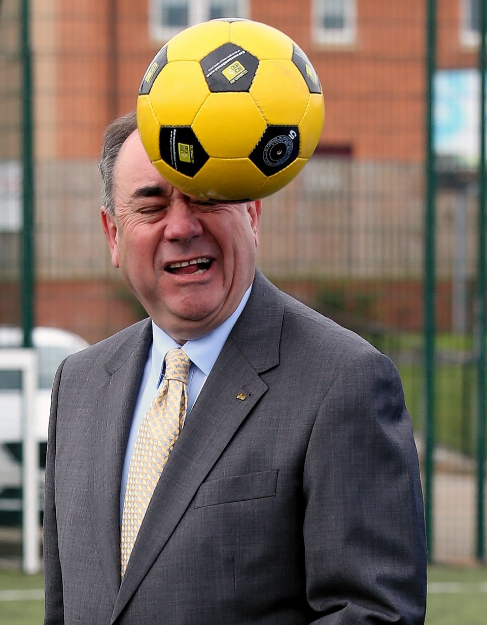 Scotland's First Minister Alex Salmond heads a ball during a Street Soccer Scotland photocall with Scotland under-21 midfielder Kenny McLean before the Scottish Cabinet meeting at Fernhill Community Centre in Rutherglen , the fifth in a series of meetings outside of Edinburgh following publication of Scotland's Future in November last year.