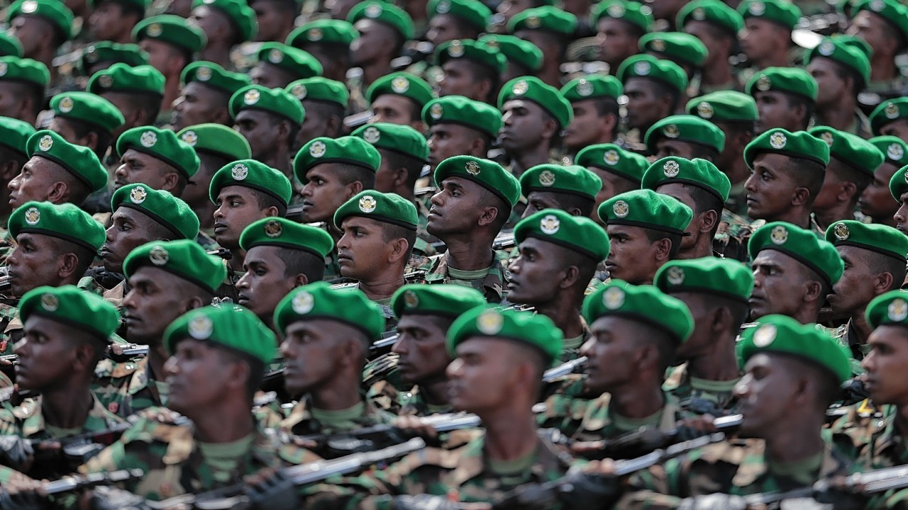 Sri Lankan army soldiers march during a Victory Day parade in Matara, about 150 kilometers (94 miles) south of Colombo, Sri Lanka