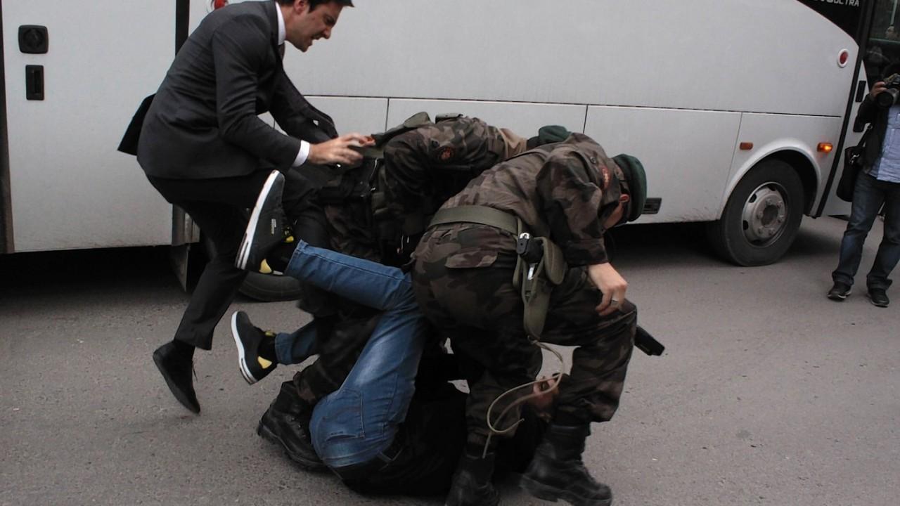 Yusuf Yerkel, advisor to Turkish Prime Minister Recep Tayyip Erdogan, kicks a protester already held by special forces police members during Erdogan's visiting  Soma, Turkey.