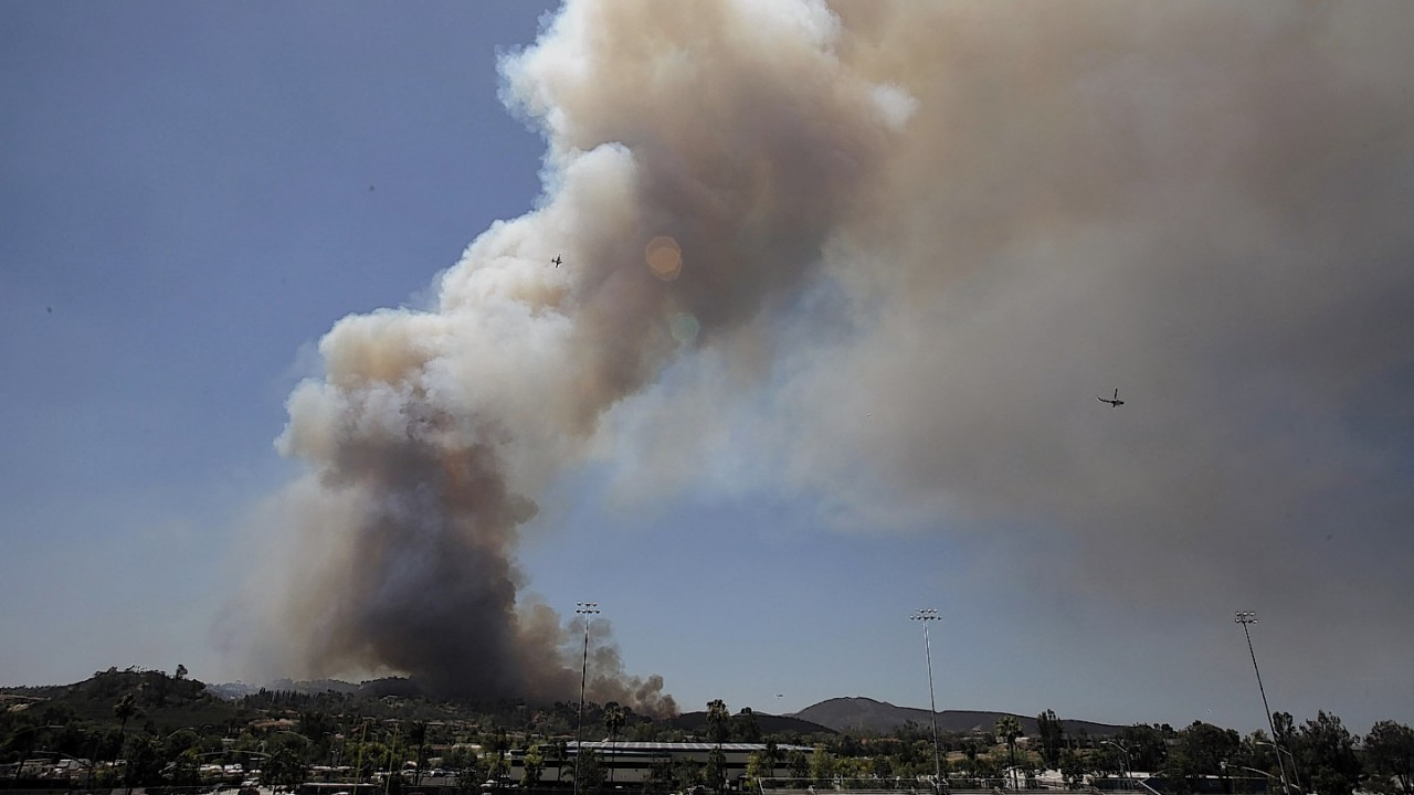 One of the nine fires burning in San Diego County suddenly flared Thursday afternoon and burned close to homes, trigging thousands of new evacuation orders.