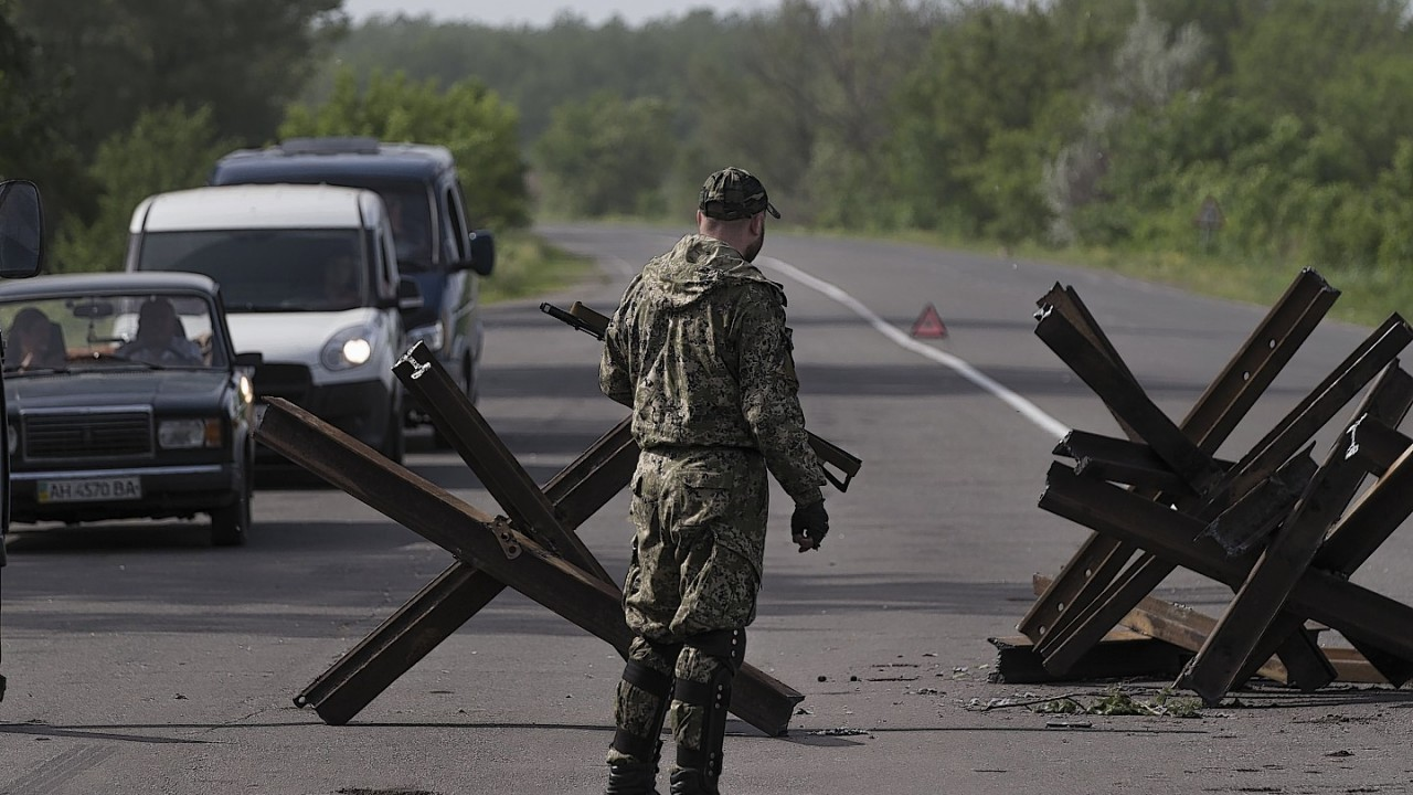 Pro-Russian militants man a checkpoint in Eastern Ukraine