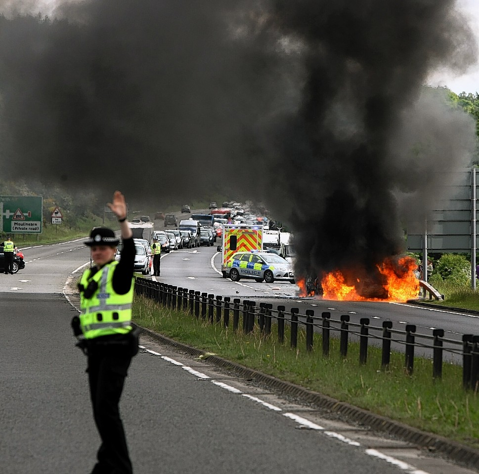 Two cars burst into flames after colliding on the A9