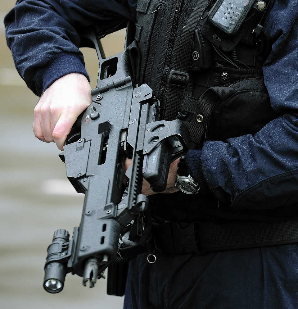 Scotland will not slip into situation where police are routinely armed, according to justice secretary.