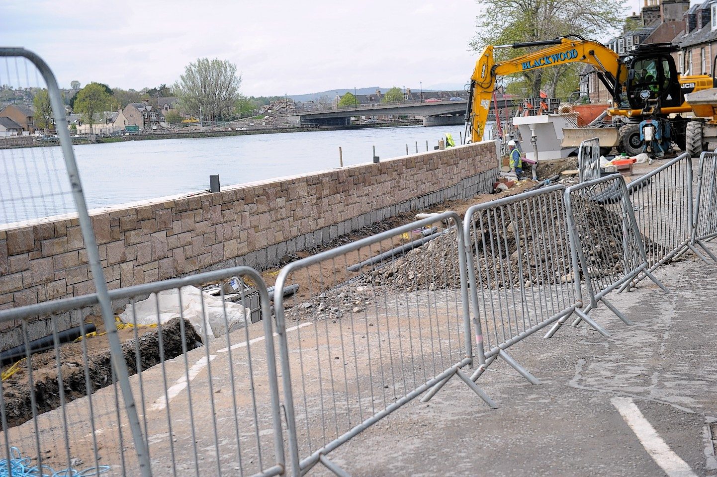Work on the Inverness flood scheme was late and over budget.