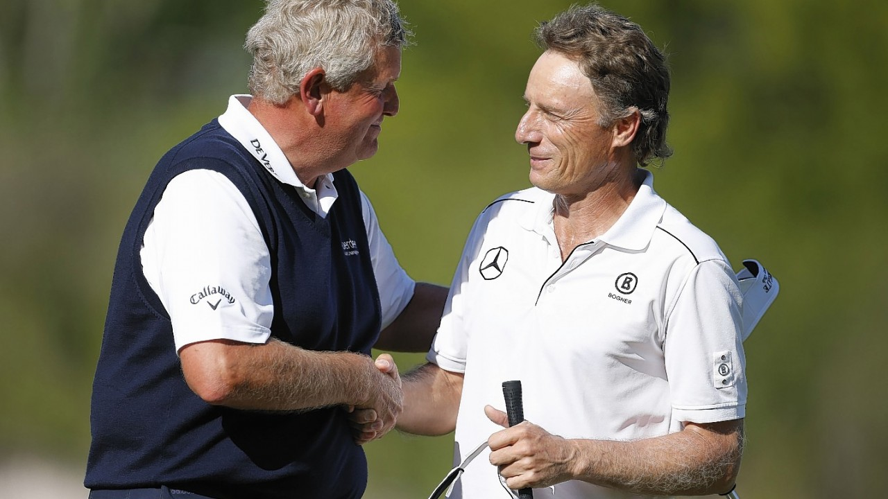 Bernhard Langer, right, congratulates Colin Montgomerie after the final round of the 75th Senior PGA Championship golf tournament at Harbor Shores Golf Club in Benton Harbor