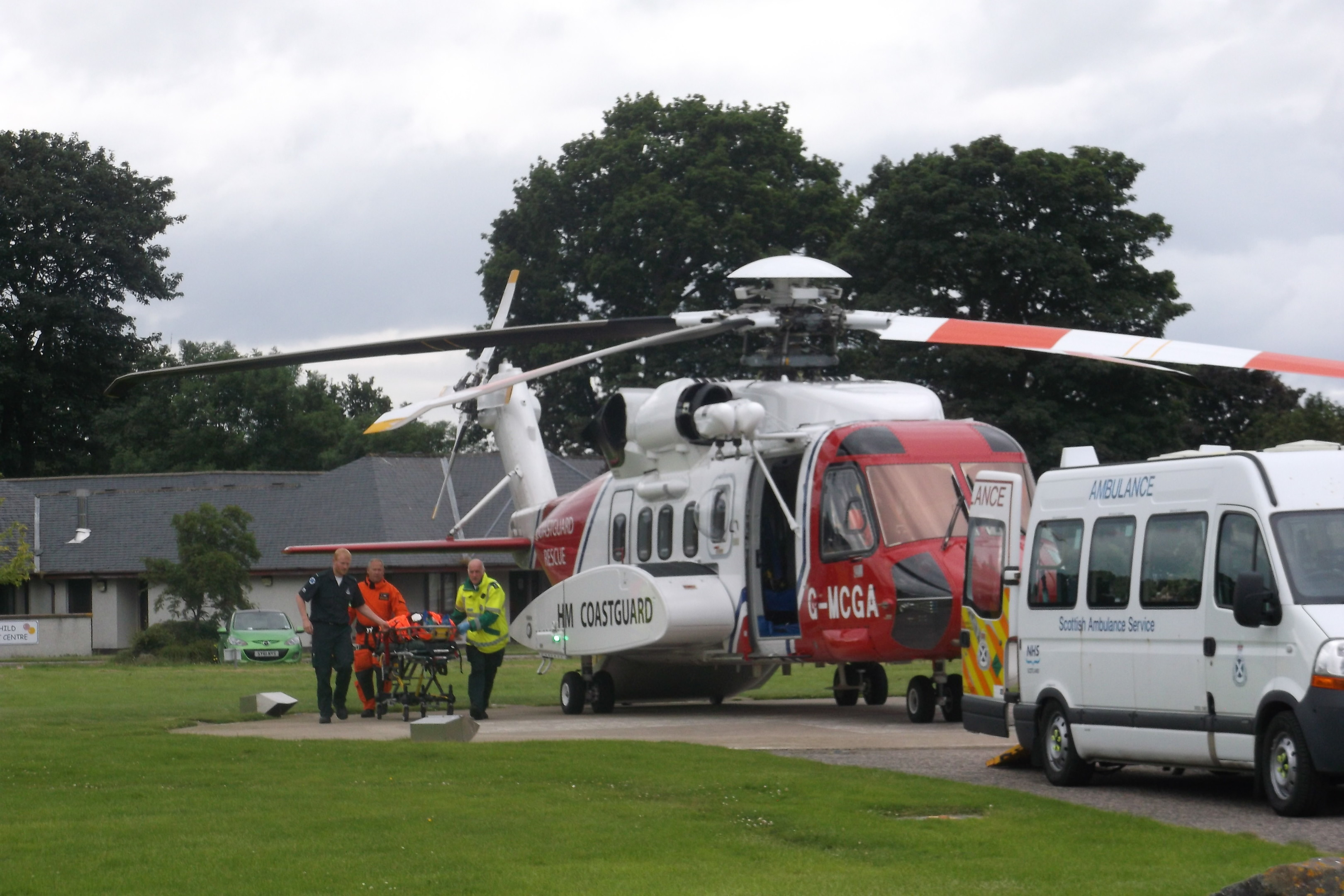 A victim from the crash at Achnasheen is taken from the air ambulance