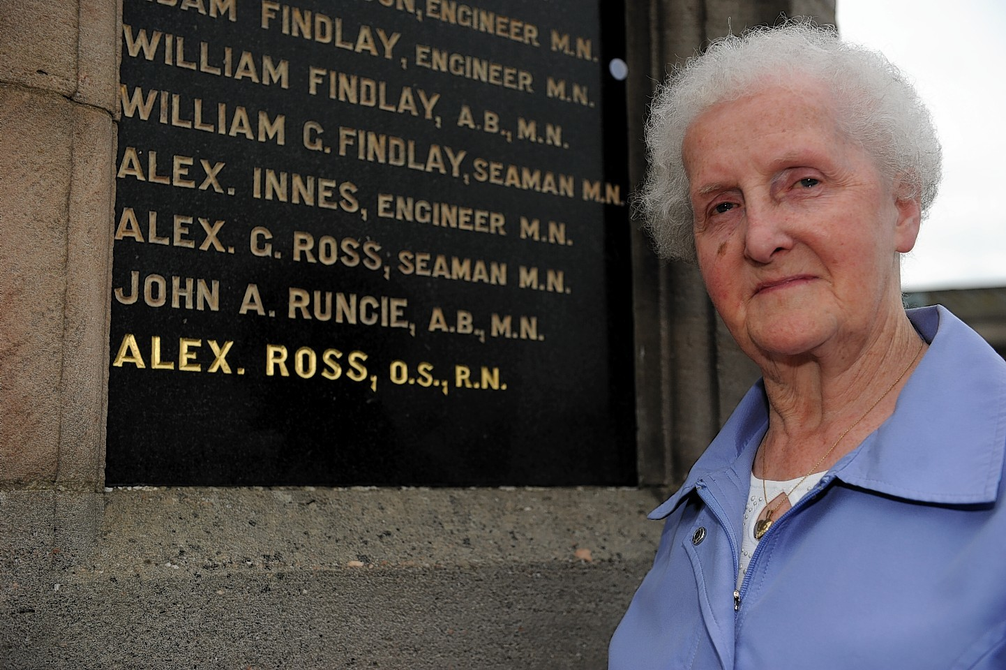 Isabel Ross next to the memorial to her cousin Alex Ross