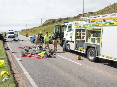 Rescue crews working at the scene of the A90 crash near Peterhead