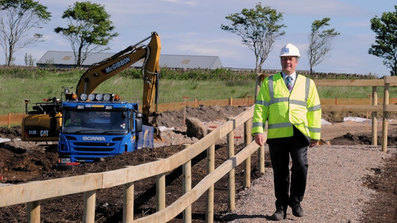 The annoncement of the prefeered bidder for the Aberdeen western peripheral route. In the picture at near Findon is Transport minister, Keith Brown.