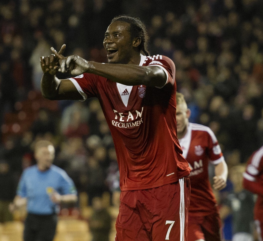 Calvin Zola celebrates scoring for Aberdeen