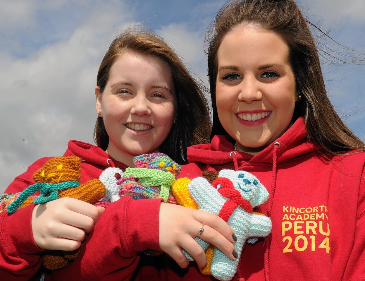 Kincorth Academy Aberdeen - pupils from the school are going to Peru to help orphans. One of the pupils grandmother has knitted over 60 teddies which they will take. (from left) Ailsa Ross, 17 (whose grandmother knitted over 60 teddies to take with them) and Aimee Gray, 16.