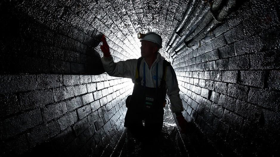 A man inside an underground sewer