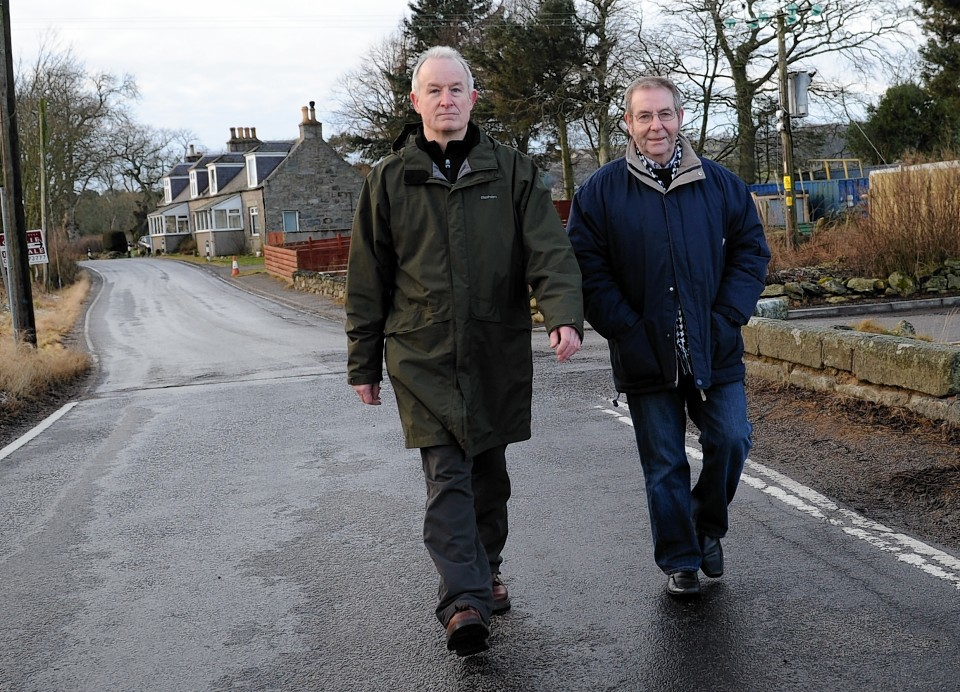 Phil Holdsworth with Westhill councillor Ron McKail on the Brodiach road in 2012.