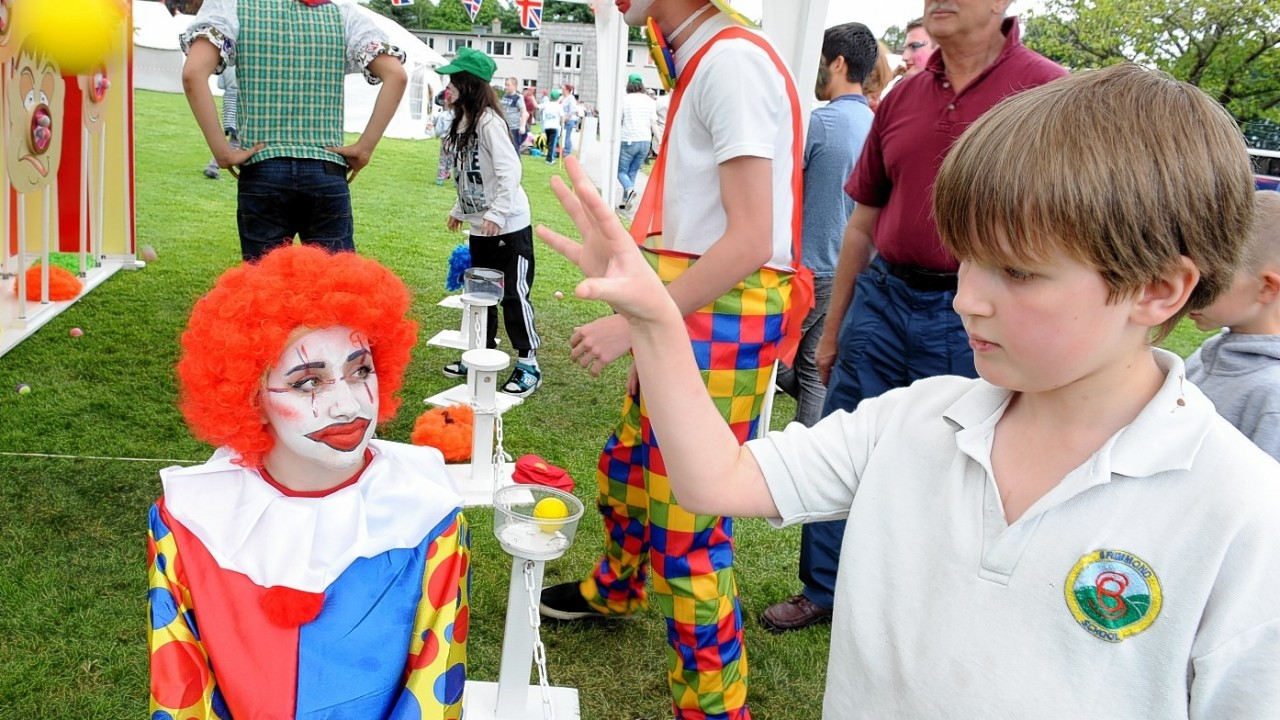 The Rotary Clubs, Kids Out day, at SRUC Craibstone , Aberdeen. In the picture is Jake Milne, Brimmond School with clown and helper, Abbie Houston, S6 Westhill Academy.