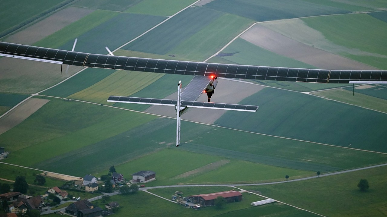 German test pilot Markus Scherdel steers the solar-powered Solar Impulse 2 aircraft for its maiden flight at its base in Payerne, Switzerland