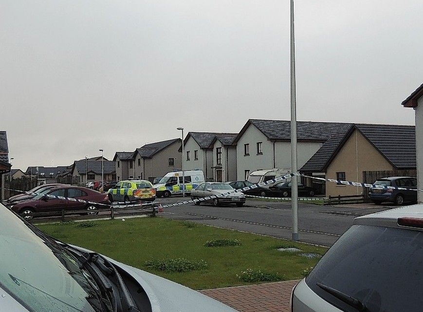Police at the scene of the incident on Alba Road, Buckpool