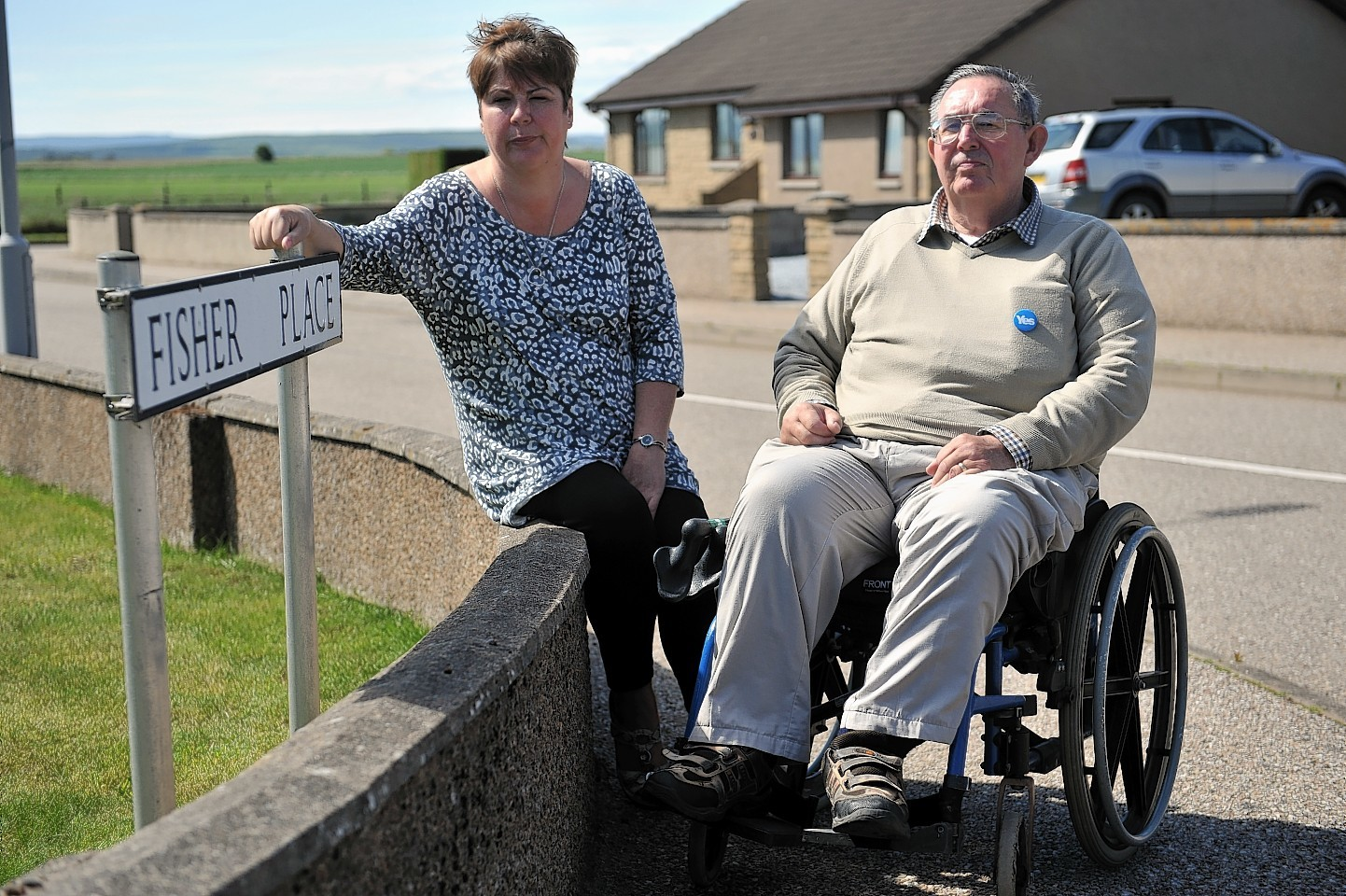 Gillian Priestley, left, and Robbie Murdoch, right, in Fisher Place, Lossiemouth which is possibly set to change from a cul-de-sac to a major thouroghfare to a new housing development