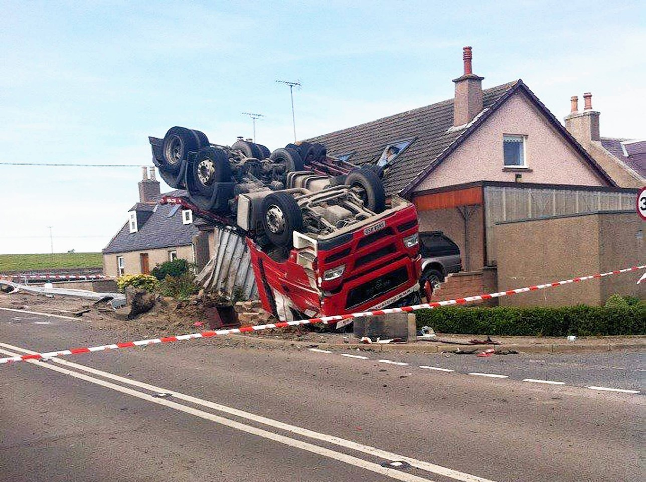 The lorry that overturned at Cortes.