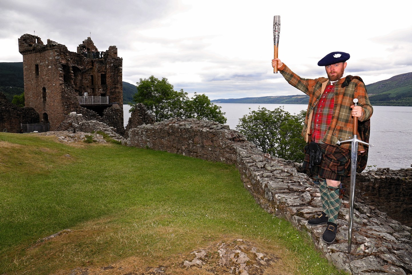 Baton reaches Urquhart Castle on the shores of Loch Ness