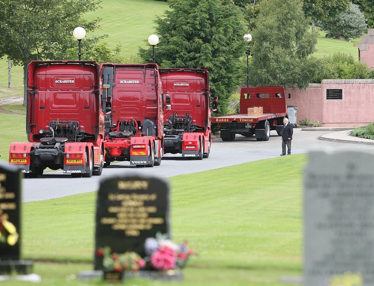 The procession of lorries in memory of Davie Crombie