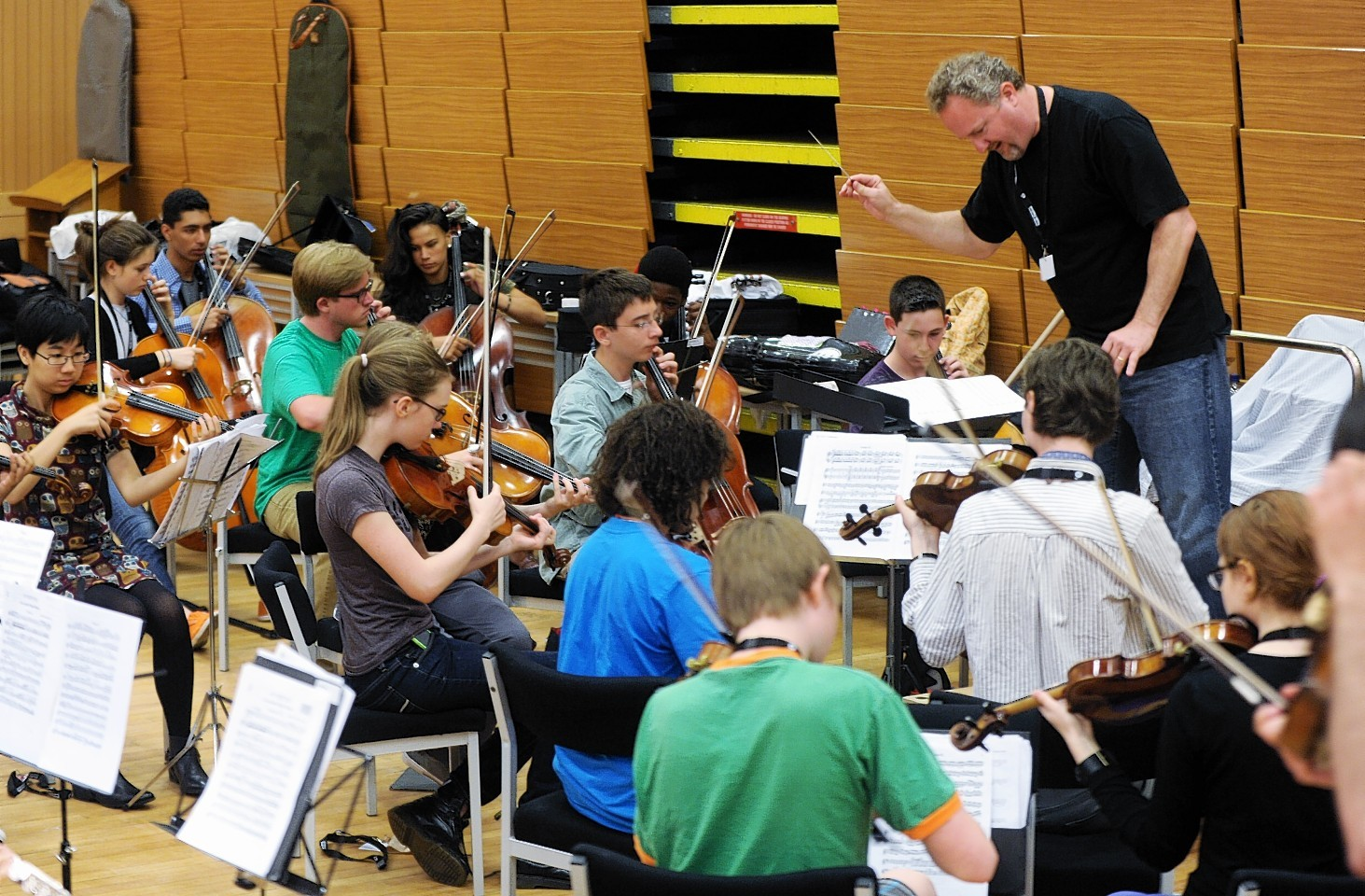 Jeffrey Grogan leads the Youth Orchestra during a rehearsal. Credit: Colin Rennie.