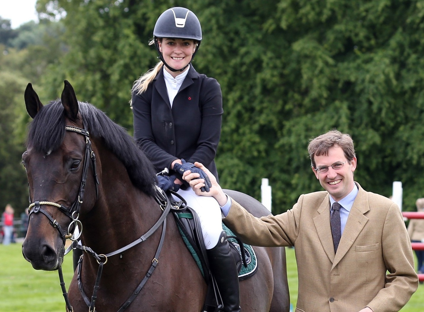 Lucy Guild being presented 1st Prize and the red rossette by Lord Hopetoun after winning the  the show jumping grand prix at Hopetoun Intenational Horse Trials on her horse Titi D'Oase