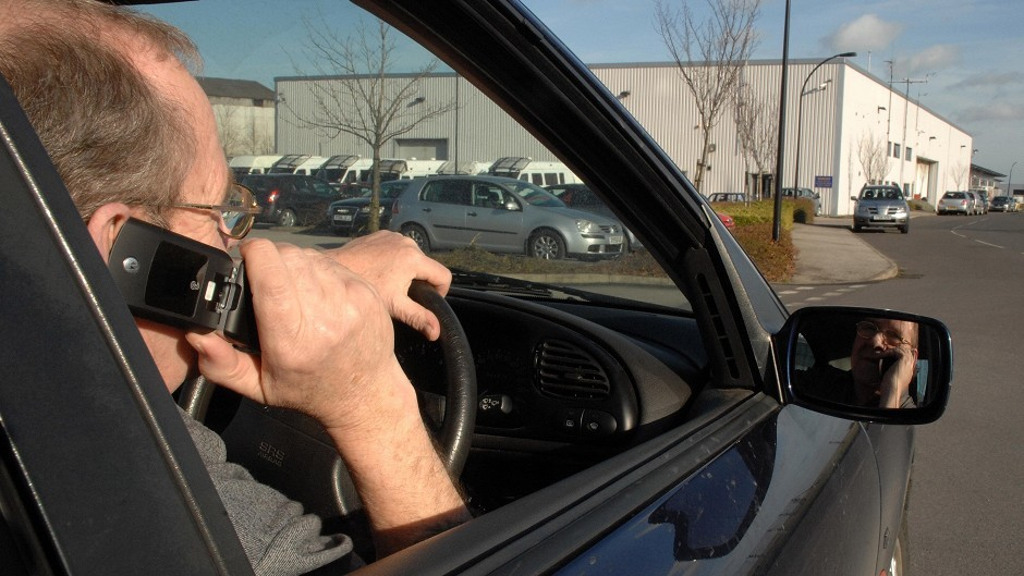 A motorist on his mobile phone while drving