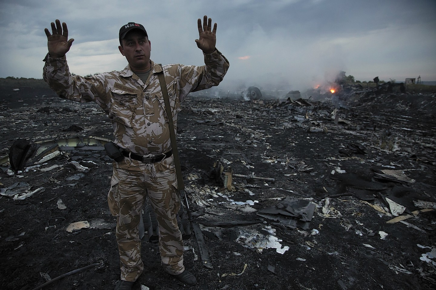 Smoke rises up at a crash site of a passenger plane, near the village of Grabovo, Ukraine (AP)