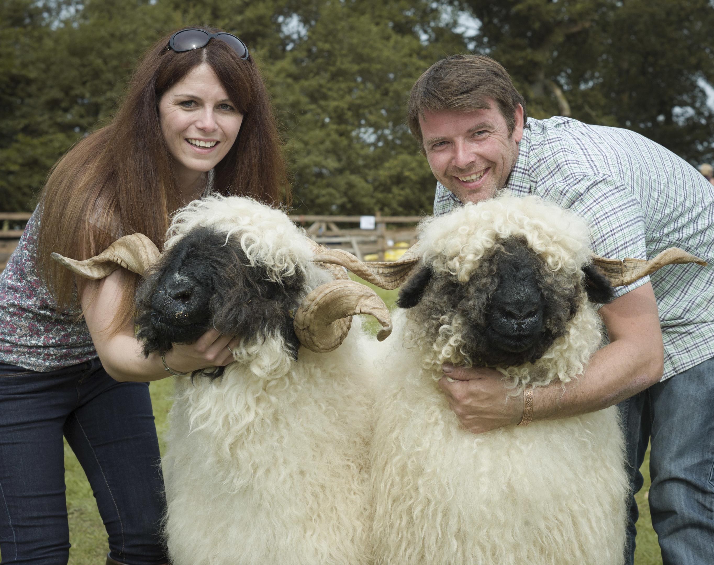 Jenni McAllister and Raymond Irvine holding a couple of their sheep.
