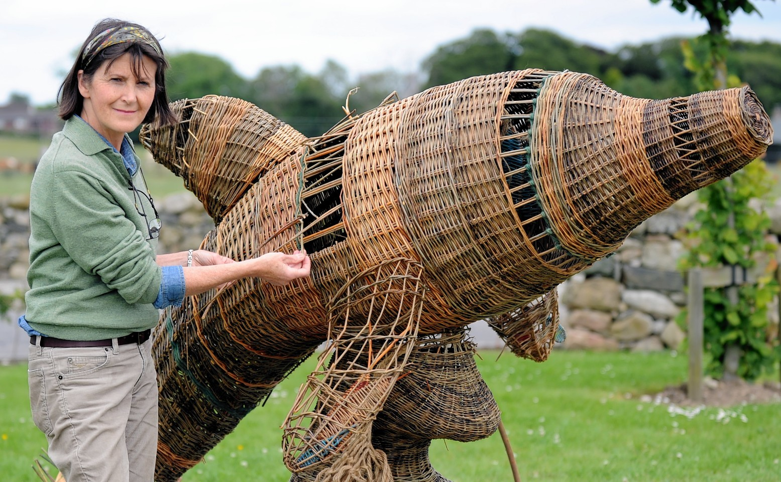 The wicker dolphin is repaired by Helen Jackson