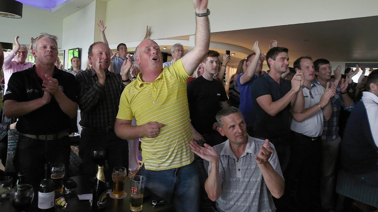 Fans watch Rory McIlroy win The Open on tv screens at Holywood Golf Course, County Down