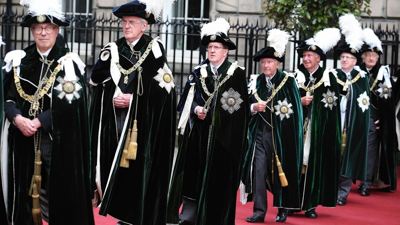 Knights of the Thistle including Lord Robertson (third from left) arrive at St Giles Cathedral in Edinburgh to  attend the Thistle Service