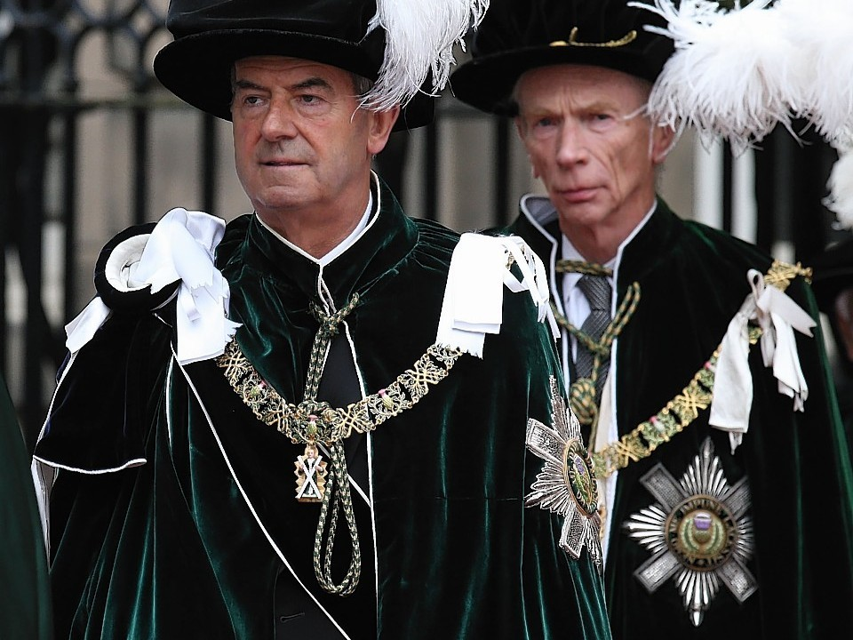 The Earl of Home and Lord Smith of Kelvin (left)  attend the Thistle service at St Giles Cathedral in Edinburgh where they were installed as Knights of the Thistle