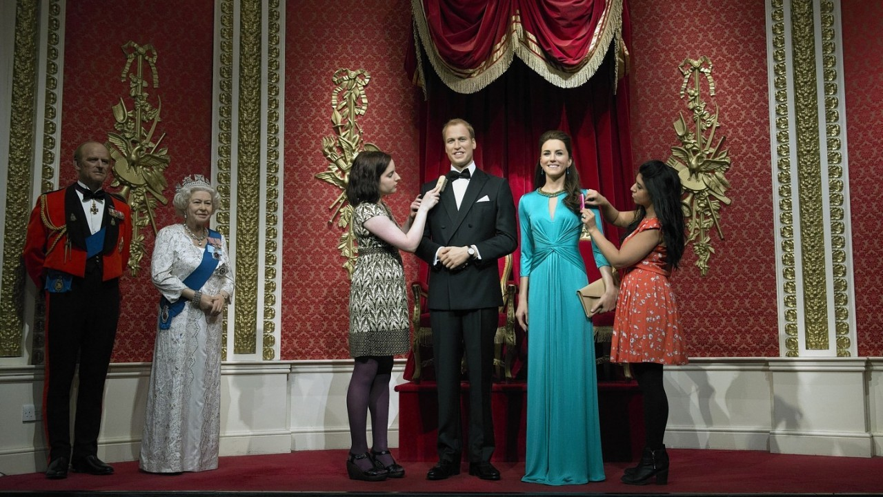Wardrobe assistant Luisa Compobassi (left) and hair stylist Caryn Bloom apply finishing touches to the wax figures of the Duke and Duchess of Cambridge as they are unveiled at Madame Tussauds, London.