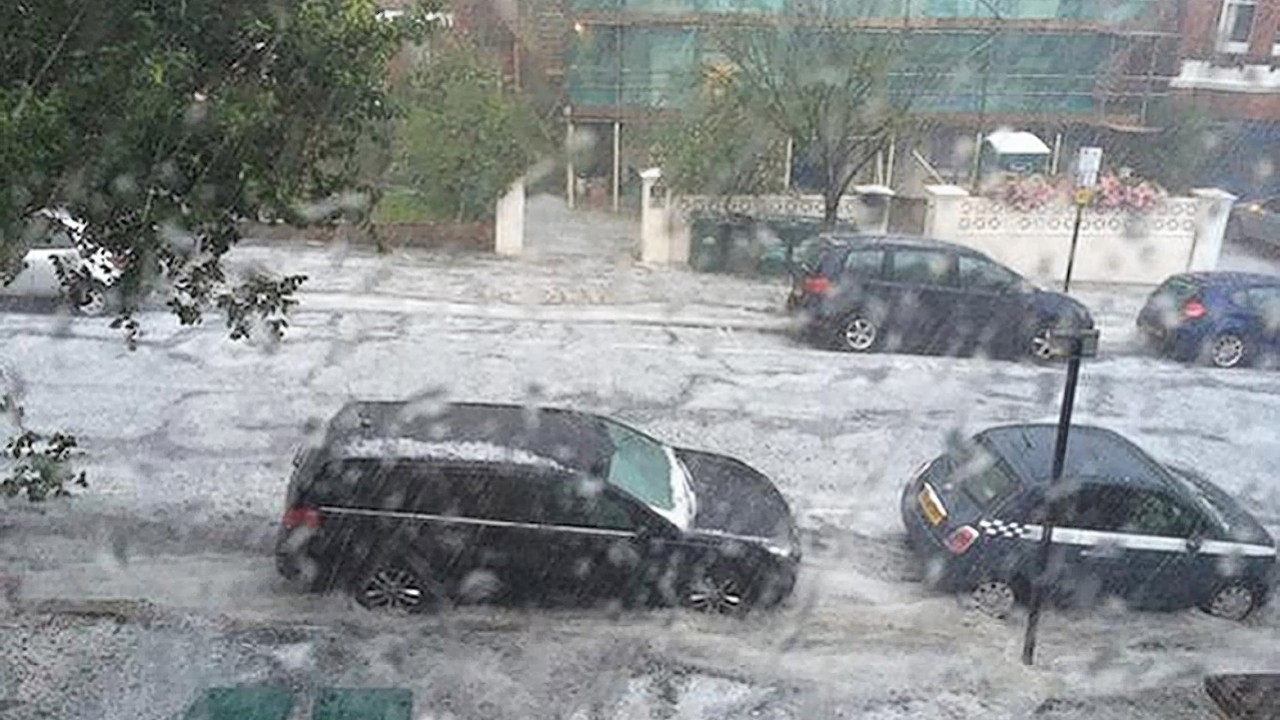 Photo taken from the Twitter feed of @lukewteth with permission of flash flooding in Wilbury Gardens in Hove