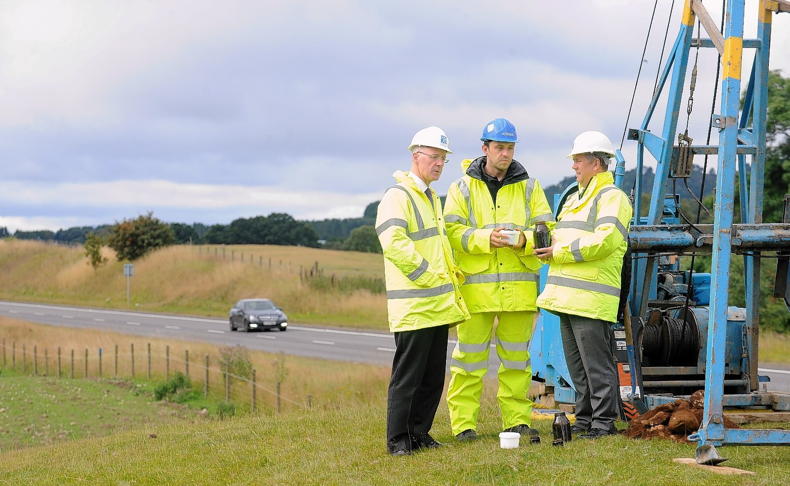 Keith Brown observes the work on the A9