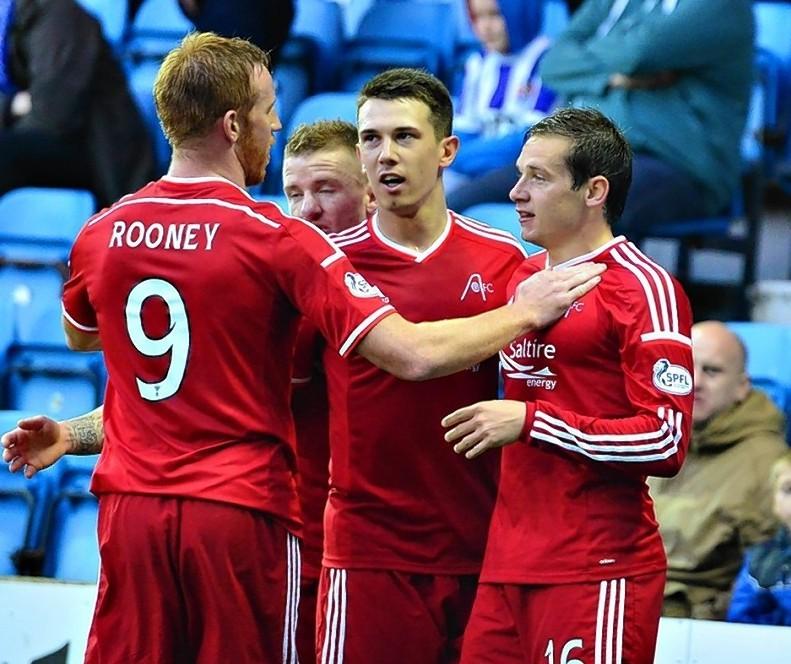 Pawlett celebrates the Dons first goal against Kilmarnock